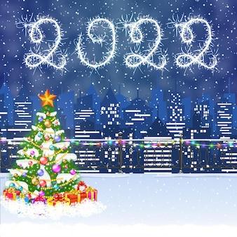 Frohes neues jahr und frohe weihnachten winter stadtbild mit weihnachtsbaum, schneeflocken. weihnachtskarte mit stadtbild und feuerwerk, 2022 mit wunderkerzen