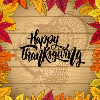 Frohes thanksgiving. grenze vom herbstlaub auf hölzernem hintergrund. türkei illustration. element für plakat, emblem, karte. illustration
