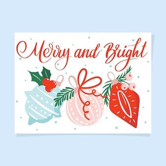 Frohes und helles weihnachtskartendesign mit ornamenten