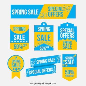 Frühling bietet etiketten in blauen und gelben farben