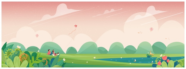 Frühling. familienausflug zum park oder picknick in der landschaft mit drachen, blumenblüte und rotwild konzept von leuten im frühjahr.