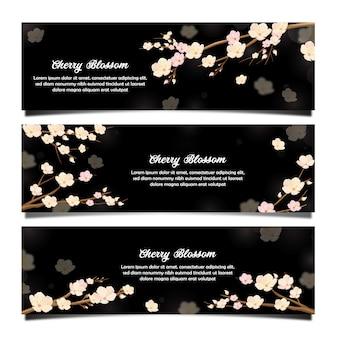 Frühlingsblume kirschblüte-fahne im schwarzen hintergrund