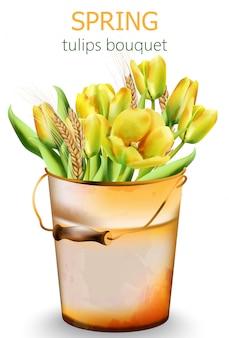 Frühlingsgelber tulpenstrauß mit weizengewürz in einem eimer