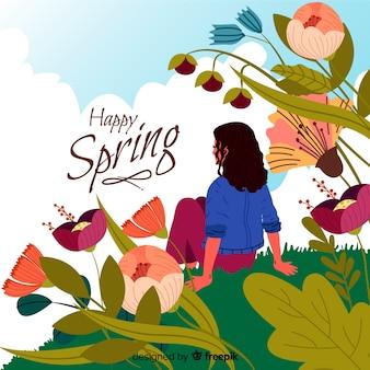 Frühlingshintergrund des mädchens sitzend