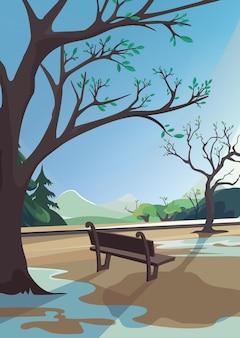 Frühlingspark auf hintergrund des waldes und der berge