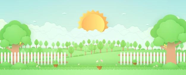 Frühlingszeit landschaftsbäume auf dem hügelgarten mit pflanzentopfschöne blume auf gras und zaun