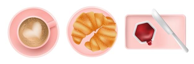 Frühstückskaffee latte in rosa tasse mit croissant