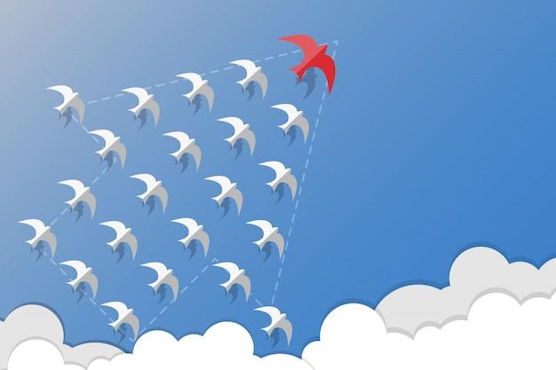 Führungs-, teamwork- und mutkonzept, weiße schwalben des rotschwalbenführers und fliegen wachsen herein pfeilform auf himmel.