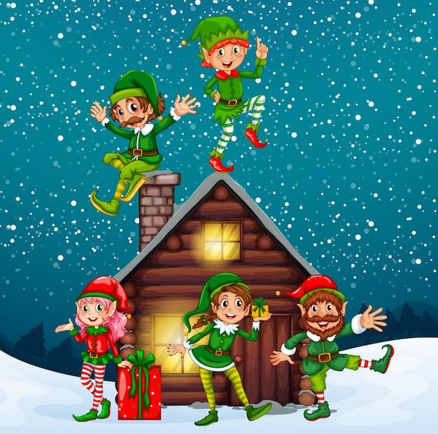 Fünf elfen in der holzhütte in der weihnachtsnacht