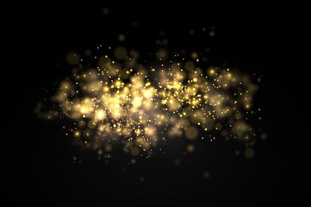 Funkelnde goldene staubpartikel bokeh weihnachtsfunkeln lichteffekt funkeln gelber funkenstern