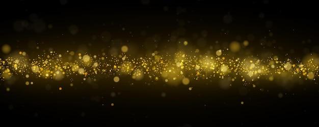 Funkelnde magische goldgelbe staubpartikel mit bokeh-effekt