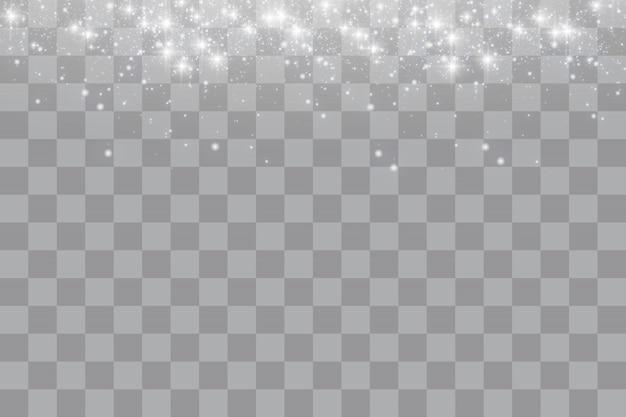 Funkelnde magische staubpartikel. die staubfunken und goldenen sterne leuchten mit besonderem licht. funkelt auf einem transparenten hintergrund. weihnachtslichteffekt.