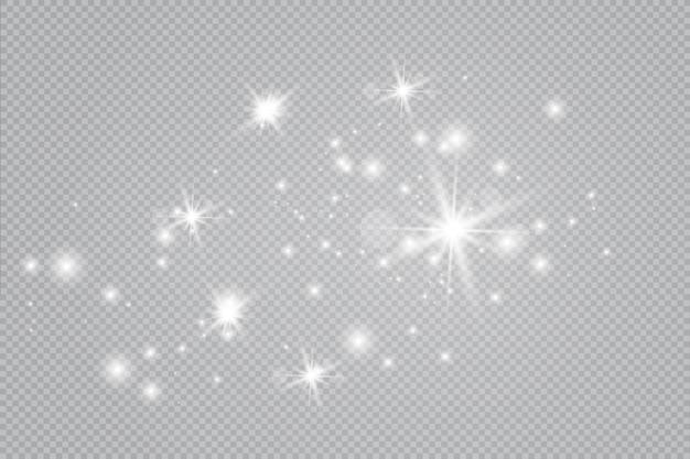 Funkelnde magische staubpartikel. die staubfunken und goldenen sterne leuchten mit besonderem licht. funkelt auf einem transparenten hintergrund.
