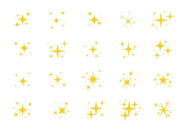 Funkelnde sterne. ein schimmernder gelber stern und ein glitzerndes element auf weißem hintergrund.