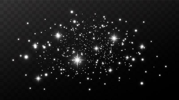 Funkelnder magischer staub. auf einem strukturierten schwarzen hintergrund. feier abstrakter hintergrund von kleinen funkelnden staubpartikeln und sternen. magische wirkung festlich.