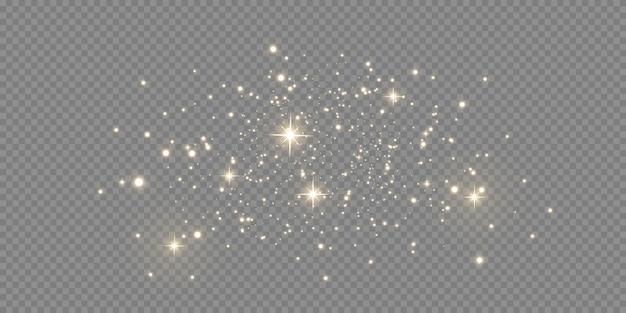 Funkelnder magischer staub. auf einem strukturierten schwarzweiss-hintergrund. feier abstrakter hintergrund gemacht von den goldenen glitzernden staubpartikeln. magische wirkung. goldene sterne.