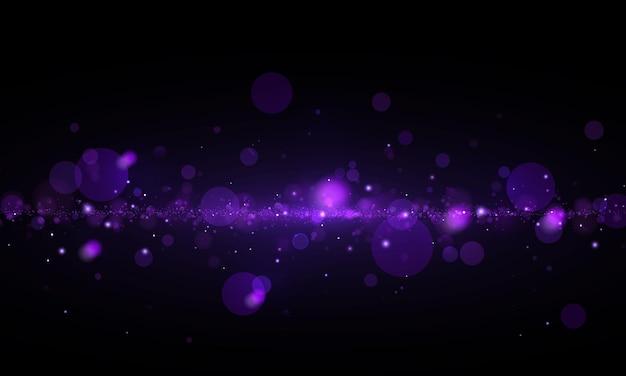 Funkelnder magischer staub und lila blaue partikel glitzer, elegant für den weihnachtszauber bokeh-effekt