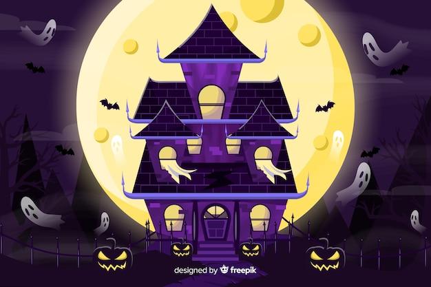 Furchtsamer halloween-hintergrund mit geisterhaus