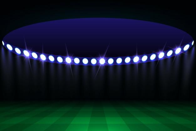 Fußballarenafeld mit hellen stadionslichtern