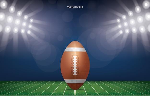 Fußballball auf fußballfeldstadionhintergrund