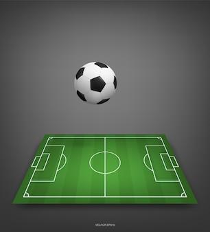 Fußballfeld oder fußballfeldhintergrund mit fußball