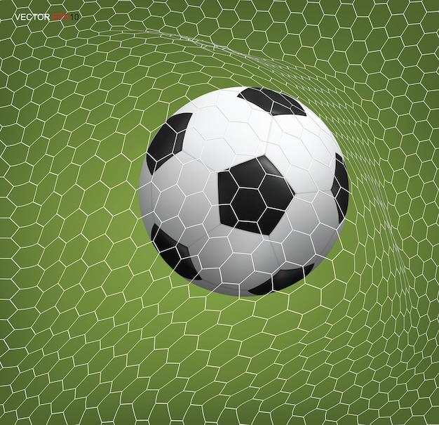 Fußballfußball im tor und im weißen netz