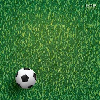 Fußballfußballball auf grünem gras des fußballplatzhintergrundes.