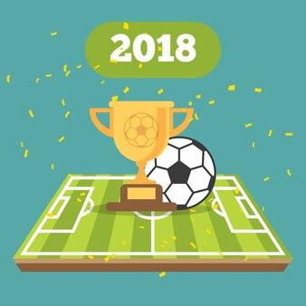 Fußballkugel auf dem feld des stadions mit cup