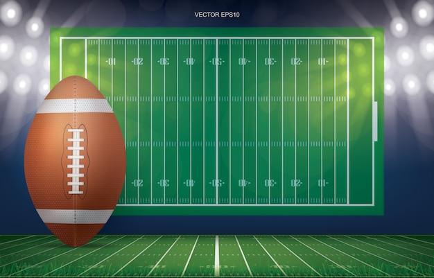 Fußballkugel auf fußballplatzstadionshintergrund.