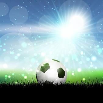 Fußballkugel im gras vor einem blauen sonnigen himmel eingebettet