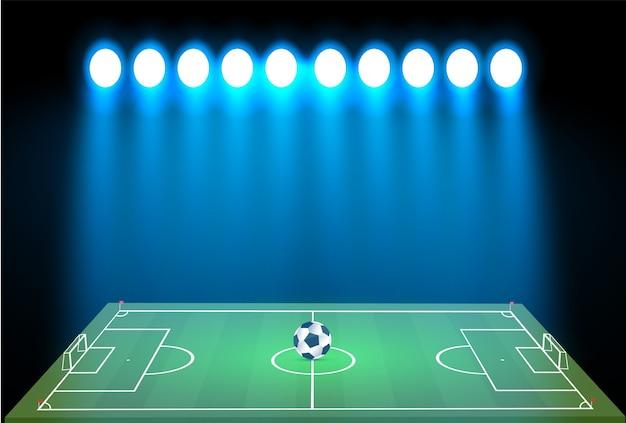 Fußballstadion mit ball auf fußballplatz und suchscheinwerfer