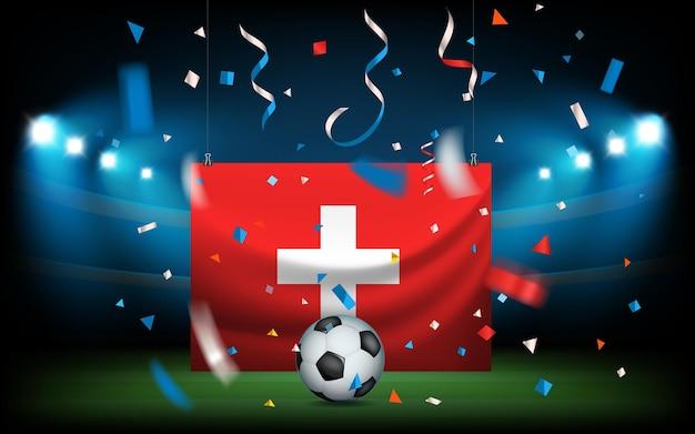 Fußballstadion mit dem ball und der flagge. die schweiz gewinnt