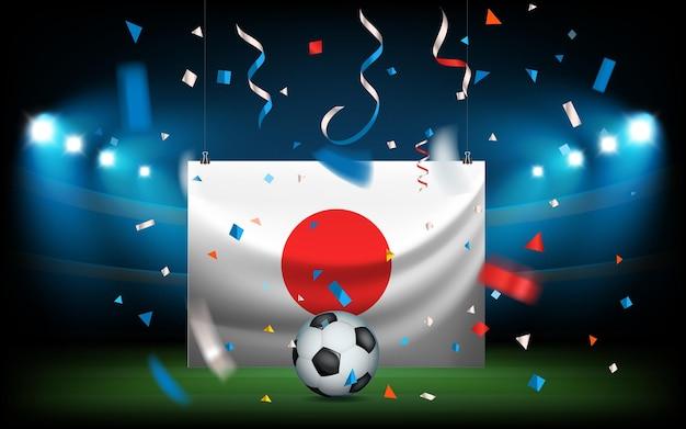 Fußballstadion mit dem ball und der flagge. japan gewinnt