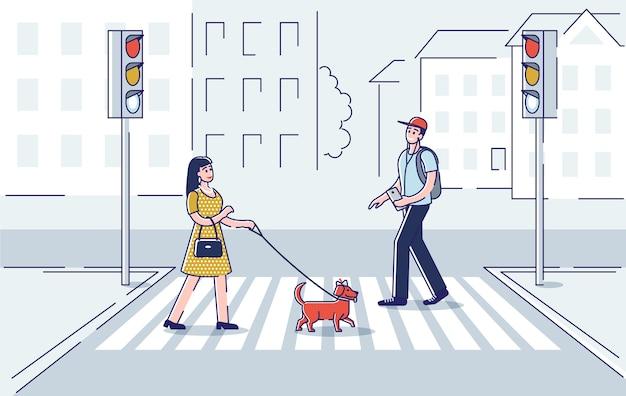 Fußgänger überqueren die straße. mann und frau mit hund, der auf zebrastreifen an grüner straßenlaterne bewegt.