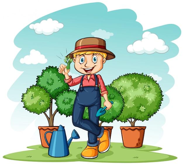 Gärtner, der seinen daumen zeigt