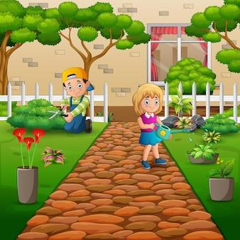 Gärtnerjunge und -mädchen, die sich um pflanzen im garten kümmern