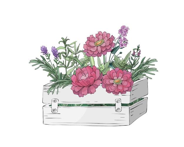 Gartenblumen und -blätter in einer holzkiste und in frischen kochenden kräutern des bauernhofes