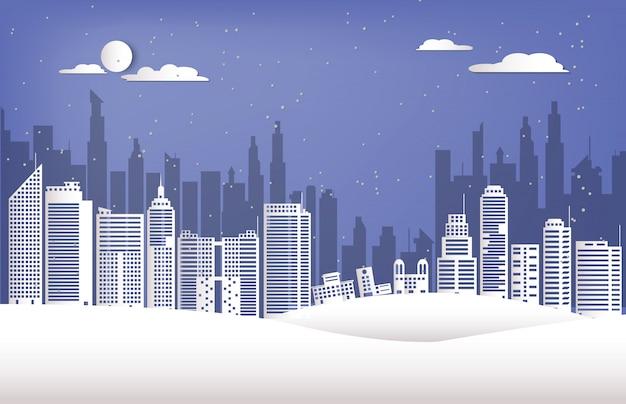 Gebäude in der stadt an der wintersaisonpapierschnittart