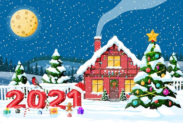 Gebäude in feiertagsverzierung mit schnee und mond