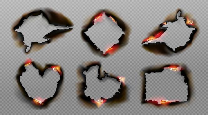 Gebrannte löcher in papier mit feuer und schwarzer asche