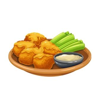 Gebratene hühnerflügel mit selleriestangen auf einer platte und sauce.