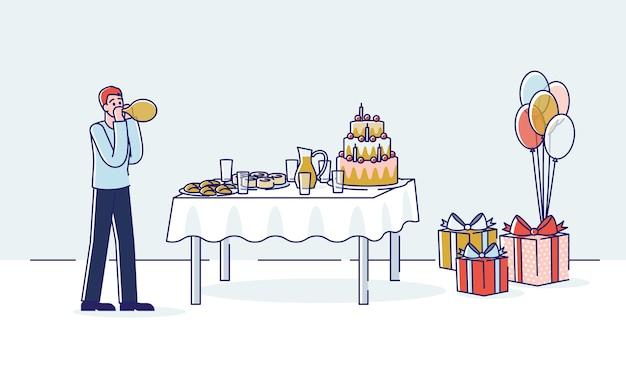 Geburtstagsdekoration: mann, der luftballons bläst, um raum für feiertagsfeier zu verzieren.
