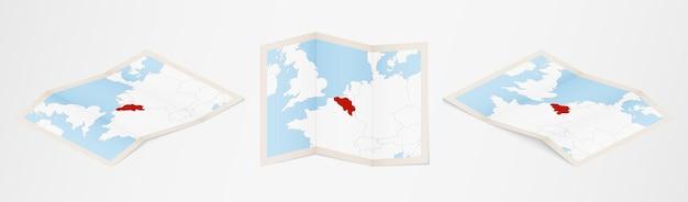 Gefaltete karte von belgien in drei verschiedenen versionen.