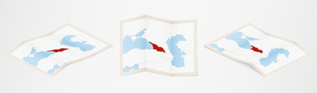 Gefaltete karte von georgien in drei verschiedenen versionen.