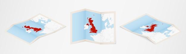 Gefaltete karte von großbritannien in drei verschiedenen versionen.