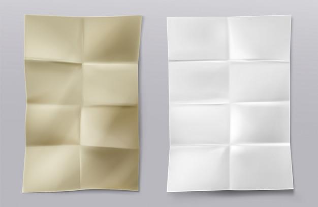 Gefaltete leere weiße und kraftpapierblätter