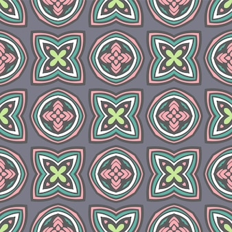 Gefliestes ethnisches buntes muster für stoff. abstraktes geometrisches mosaik blüht und kreist nahtloses muster dekorativ ein.