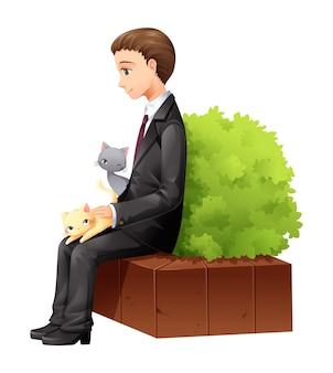 Gehaltsmann spielt mit katze während der pause