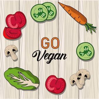 Gehen sie vegane beschriftung mit gemüse im hölzernen hintergrund herum