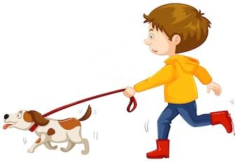 Gehender Hund des kleinen Jungen